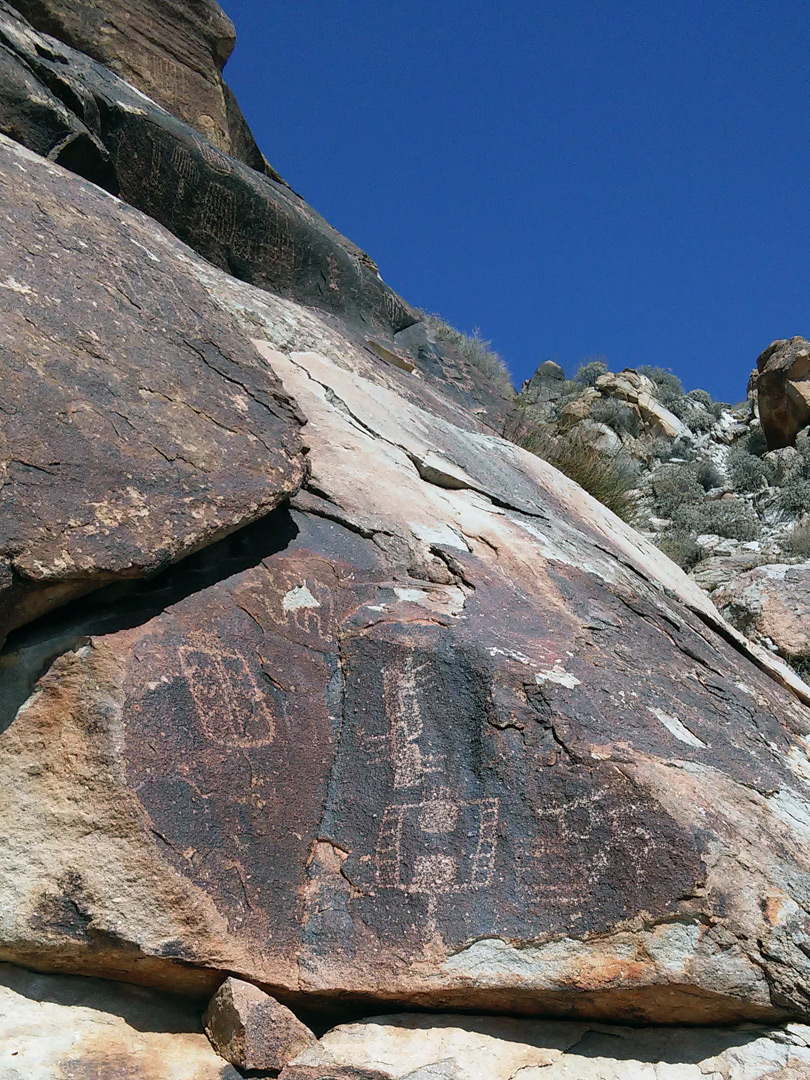 Petroglyphs on a sloping cliff
