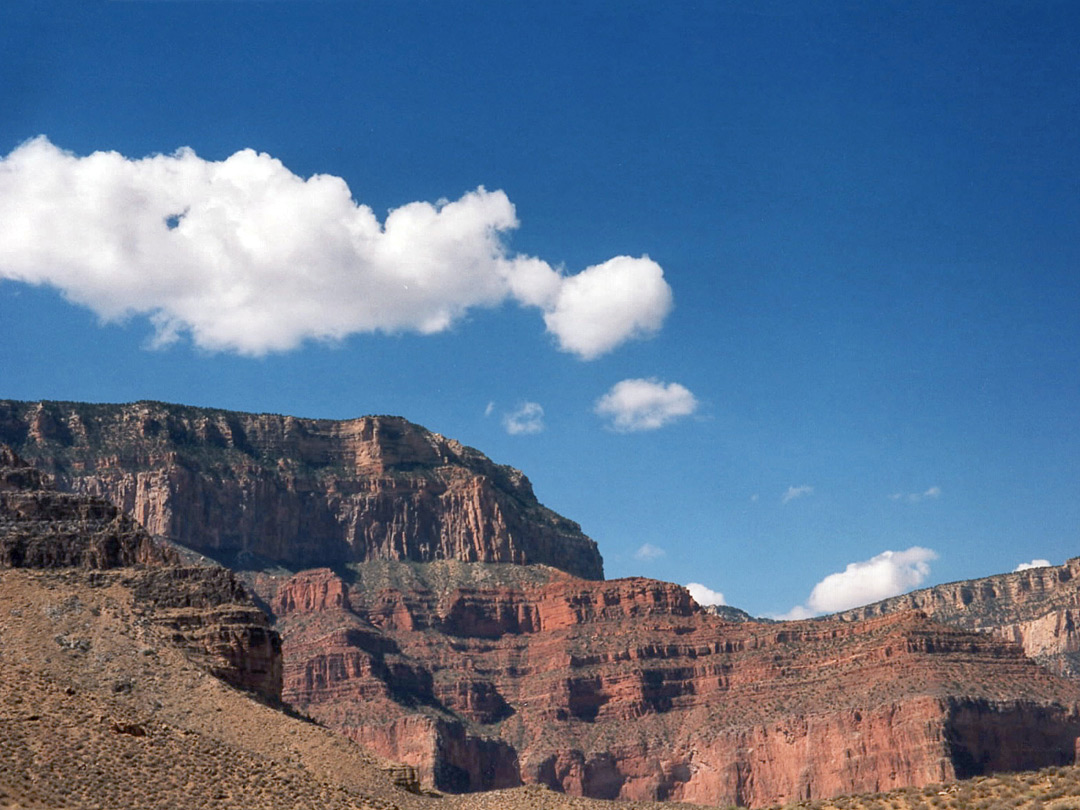 Clouds above red cliffs
