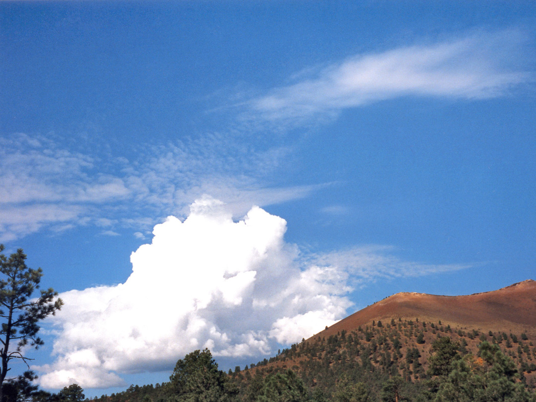 Thundercloud above a cinder cone