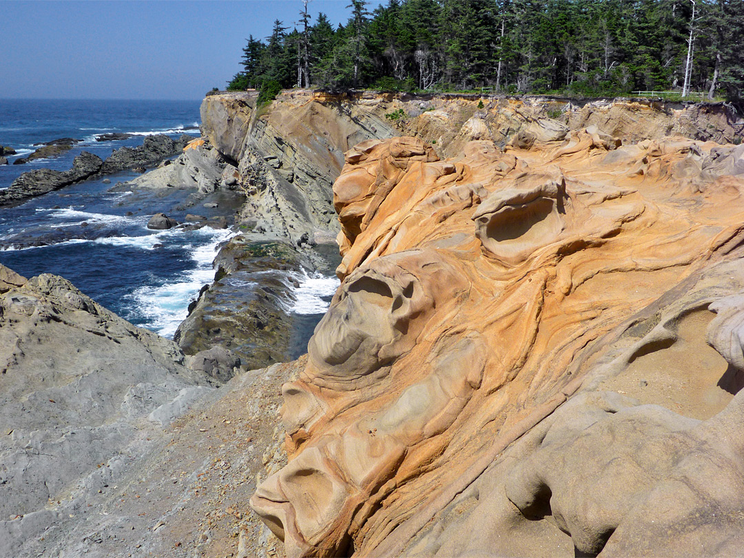 Swirling orange sandstone at Shore Acres, near the old tennis courts Pacific Ocean Waves