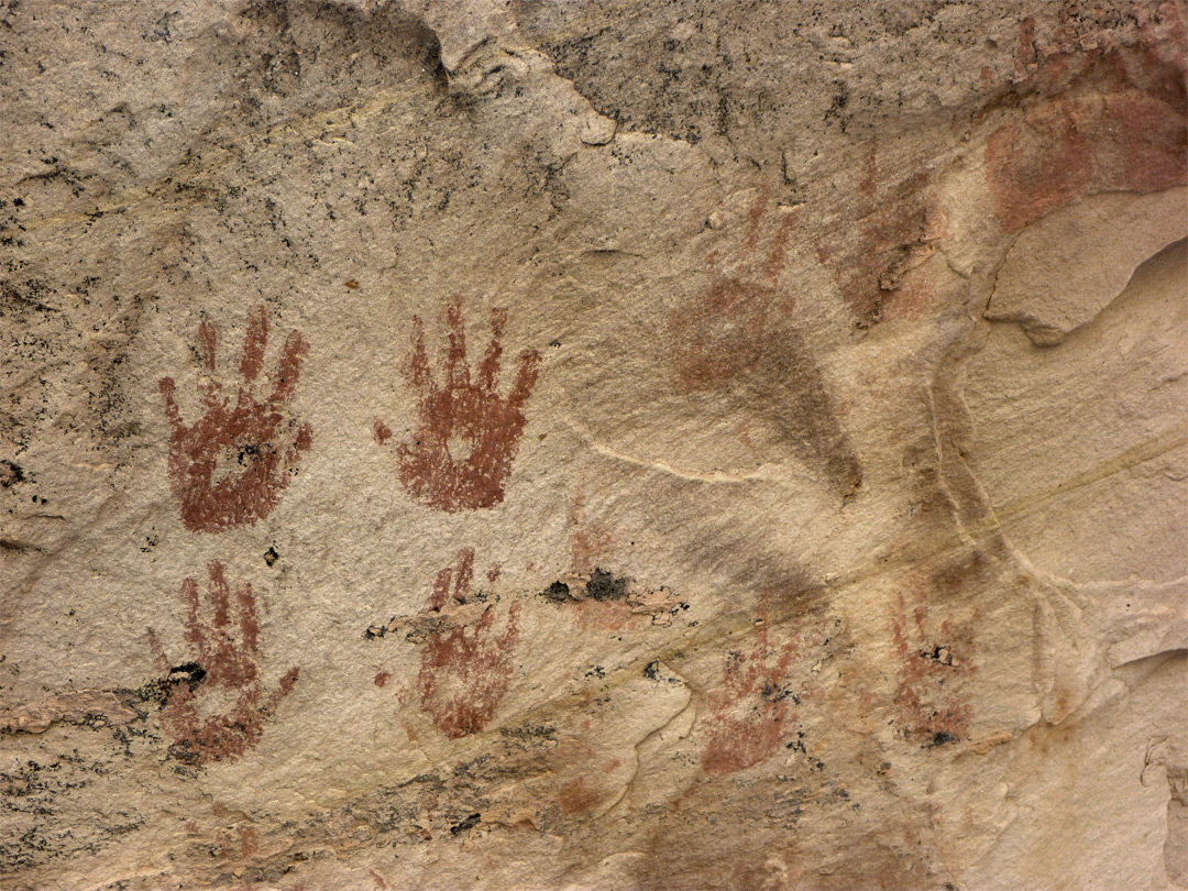 Red handprint pictographs